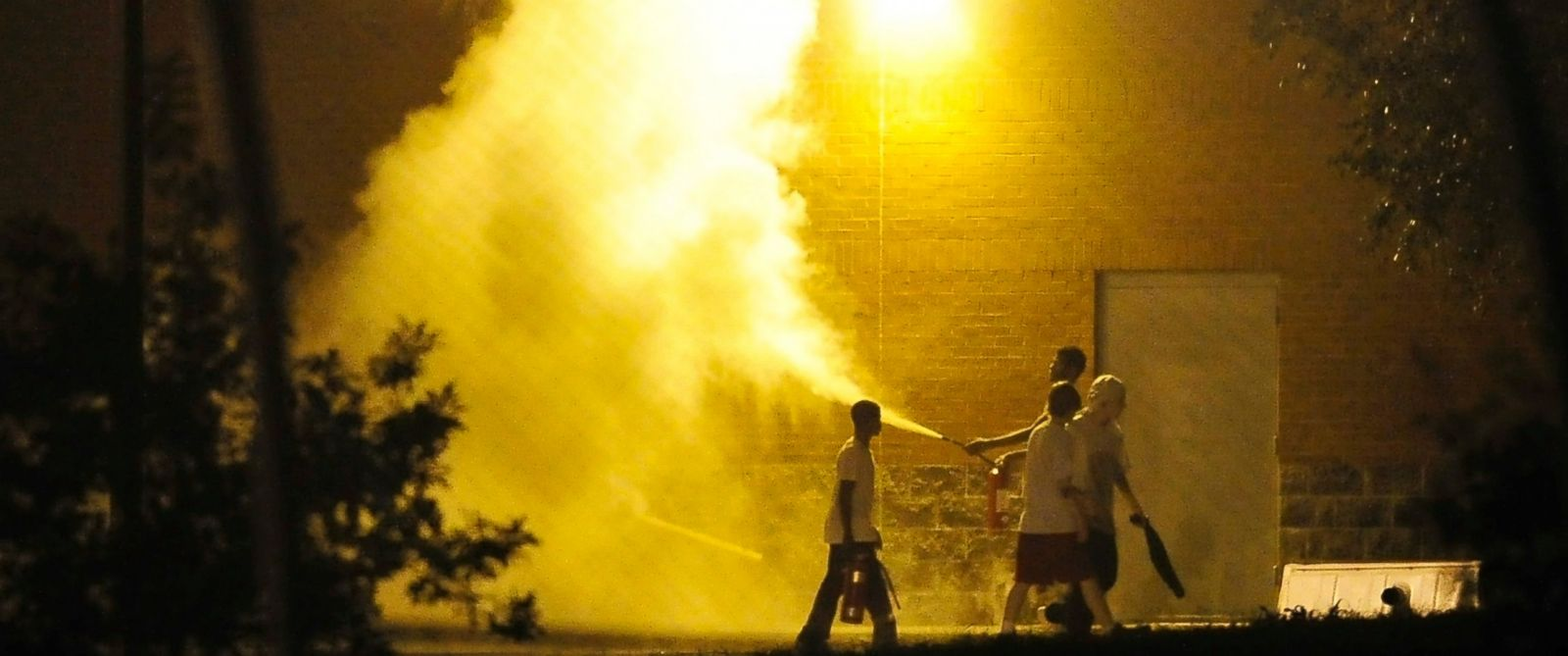 PHOTO: Teenagers spray a fire extinguisher at the Woodland Hills Youth Development Center in Nashville, Tenn., Sept. 4, 2014.