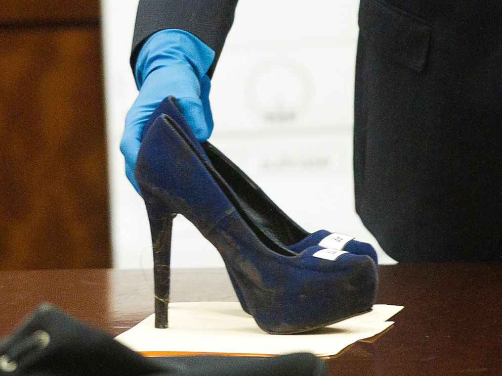 PHOTO: Prosecutor John Jordan sets down a stiletto shoe entered into evidence during the trial against Ana Lilia Trujillo, April 1, 2014, in Houston.