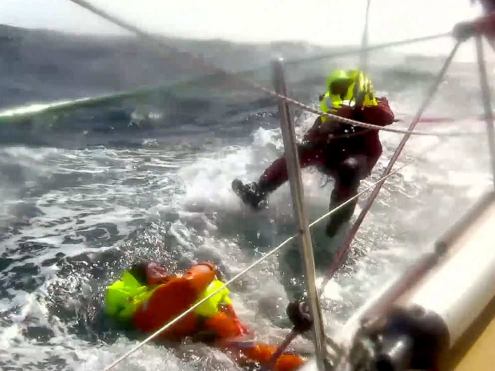 PHOTO: Andrew Taylor, 46, left, from London is shown during his rescue after falling overboard from the 70-foot yacht, the Derry-Londonderry-Doire, during the Clipper Round the World Yacht Race, Monday, March 31, 2014.