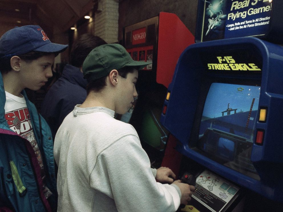 PHOTO: Raymond Freda plays the new F-15 Strike Eagle video game at an arcade in New York in this Jan. 28, 1991, file photo as his friend Brian Valenza looks on.