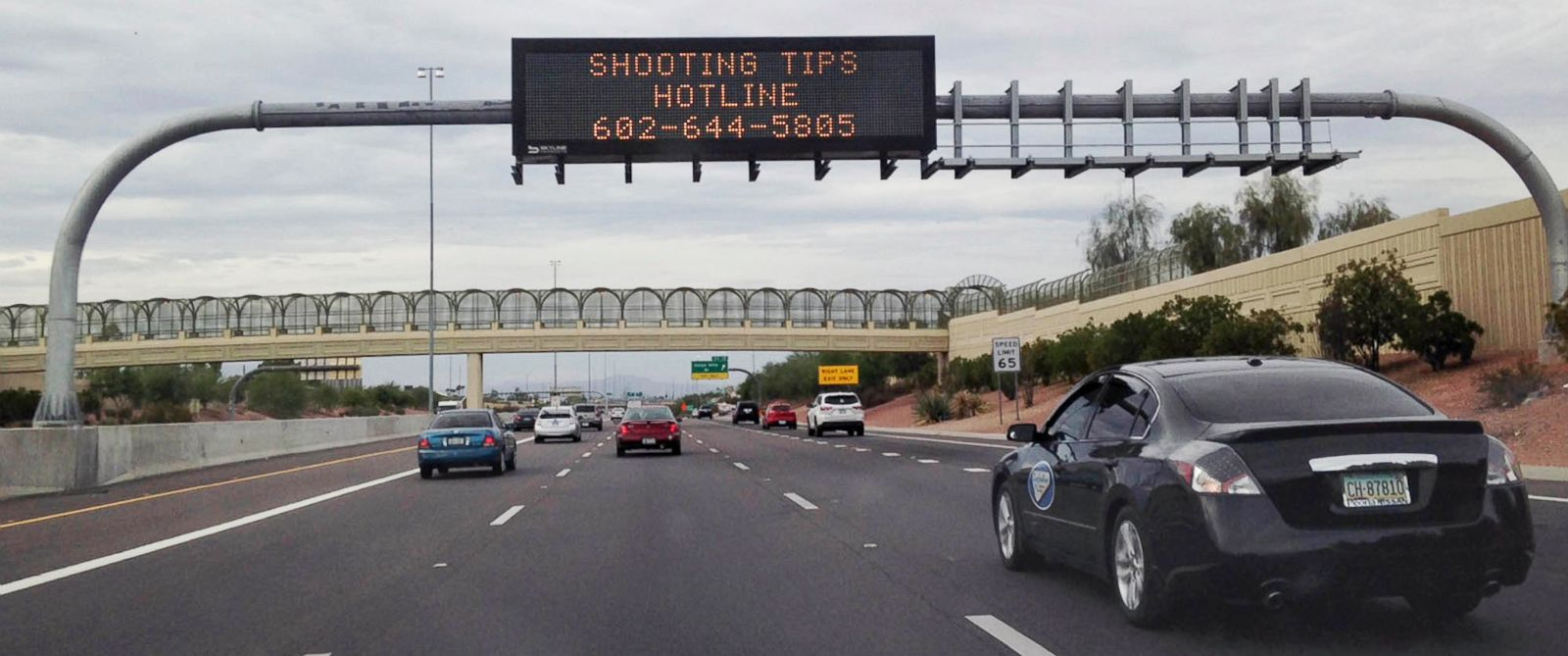 PHOTO: An Arizona Department of Transportation sign gives a hotline number for information on the recent freeway shootings, Sept. 9, 2015 near Phoenix, Ariz.