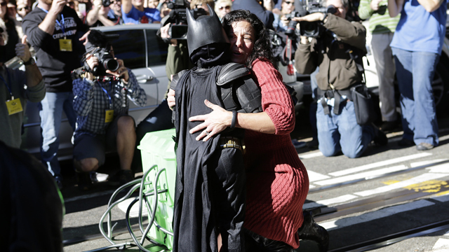 PHOTO: Miles Scott, 5, dressed as Batkid, rescues a damsel in distress in San Francisco, Nov. 15, 2013.