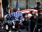 PHOTO: The casket containing the body of Boston firefighter Michael R. Kennedy is carried off his fire truck before his funeral outside Holy Name Church in Boston, April 3, 2014.