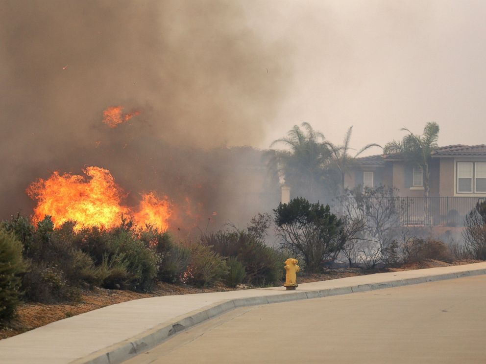 PHOTO: A wildfire climbs a canyon toward homes, May 14, 2014, in Carlsbad, Calif.