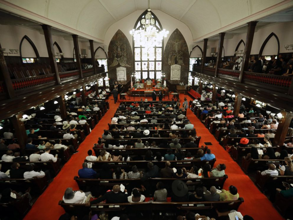 PHOTO: Parishioners sit at the Emanuel A.M.E. Church four days after a mass shooting that claimed the lives of its pastor and eight others, June 21, 2015, in Charleston, S.C.