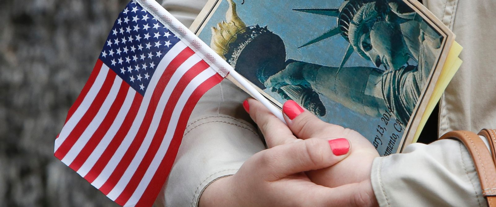 PHOTO: In this file photo, Kristina Drobot holds an American flag as she waits to be sworn-in as a U.S. citizen during naturalization ceremonies at the Old Governors Mansion in Sacramento, Calif., Feb. 13, 2014.