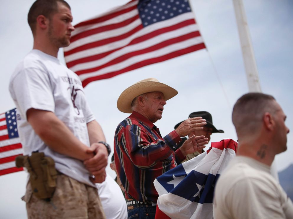 PHOTO: Flanked by armed supporters, rancher Cliven Bundy speaks at a protest camp near Bunkerville, Nev. Friday, April 18, 2014.