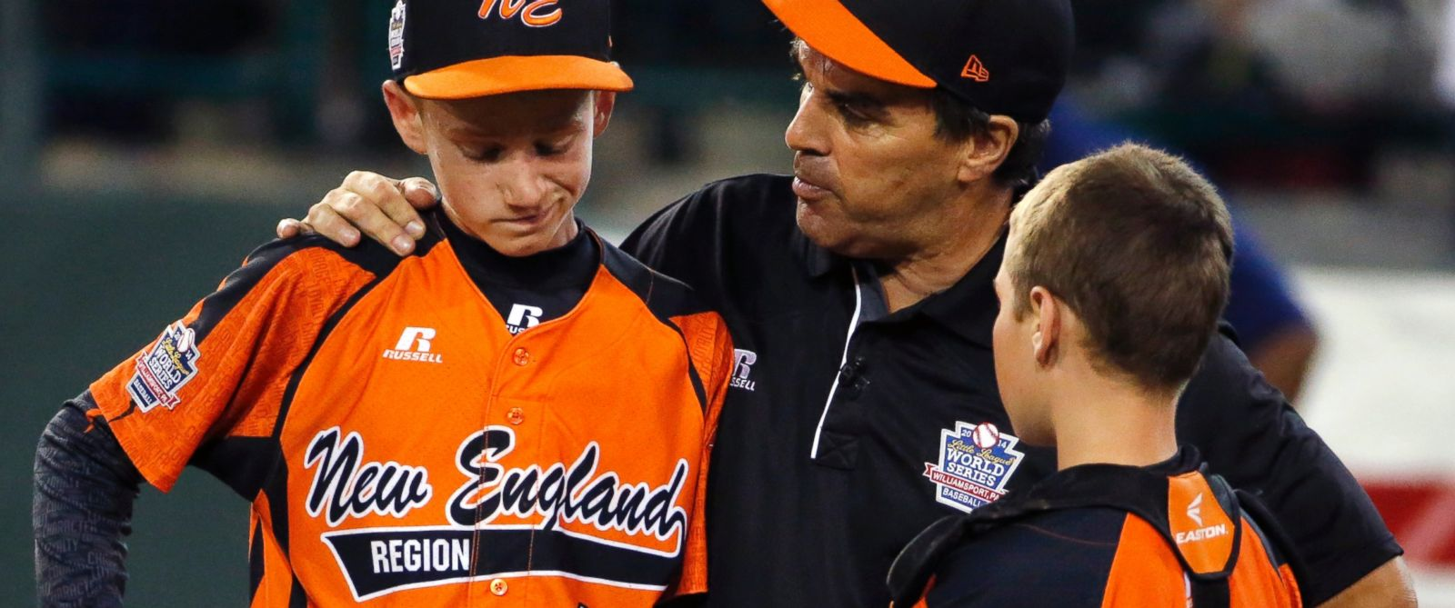 PHOTO: Cumberland manager David Belisle, center, talks with pitcher CJ Davock, left, and catcher Trey Bourque during the Little League World Series tournament in South Williamsport, Pa., Aug. 18, 2014.