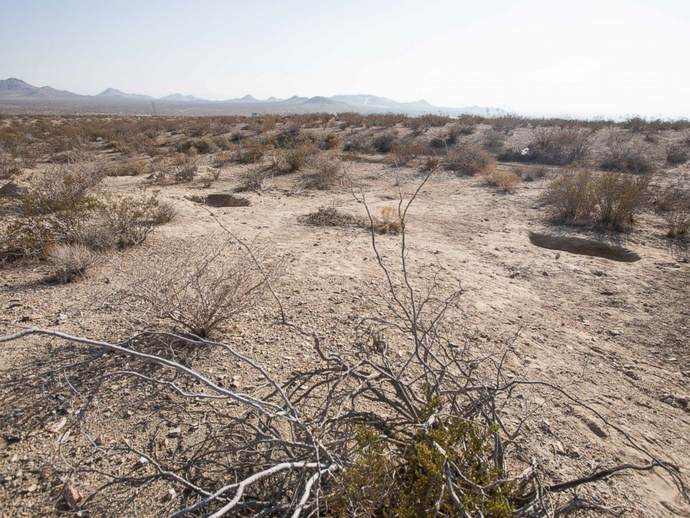 PHOTO: Two shallow graves are seen at the site on the outskirts of Victorville that contained the skeletal remains of members of missing McStay family, Nov. 15, 2013, in San Bernardino, Calif.
