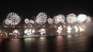 PHOTO: Fireworks explode over the Jumeirah Palm Island at midnight to celebrate the New Year, Jan. 1, 2014, in Dubai, United Arab Emirates.