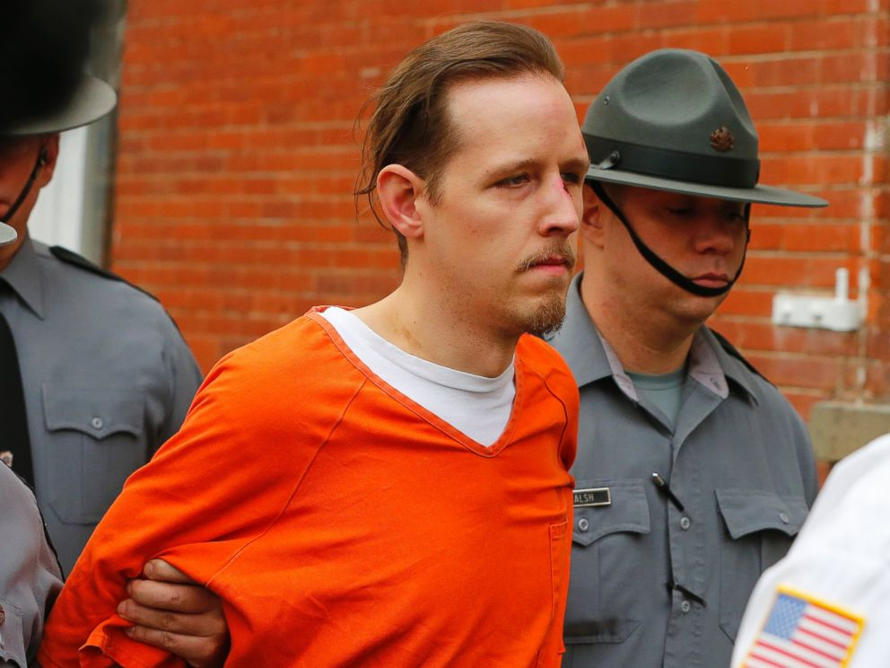 PHOTO: Eric Frein is escorted by police out the Pike County Courthouse after his arraignment in Milford, Pa., Oct. 31, 2014.