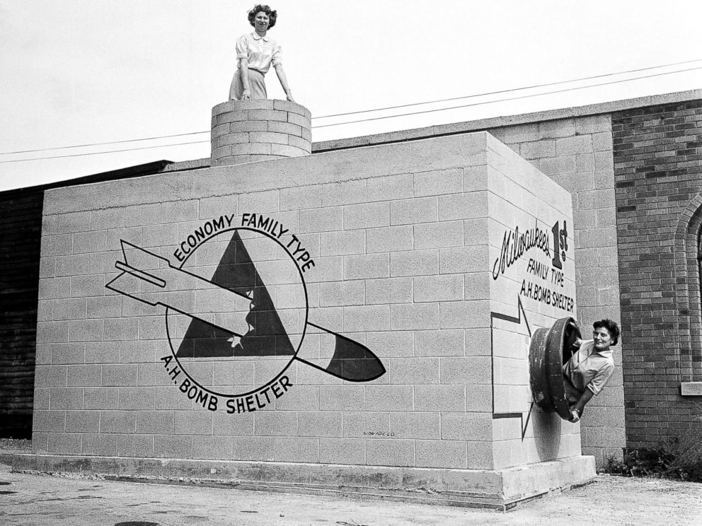 PHOTO: Women emerge from a new family-type bomb shelter on display in Milwaukee, Sept. 12, 1958.