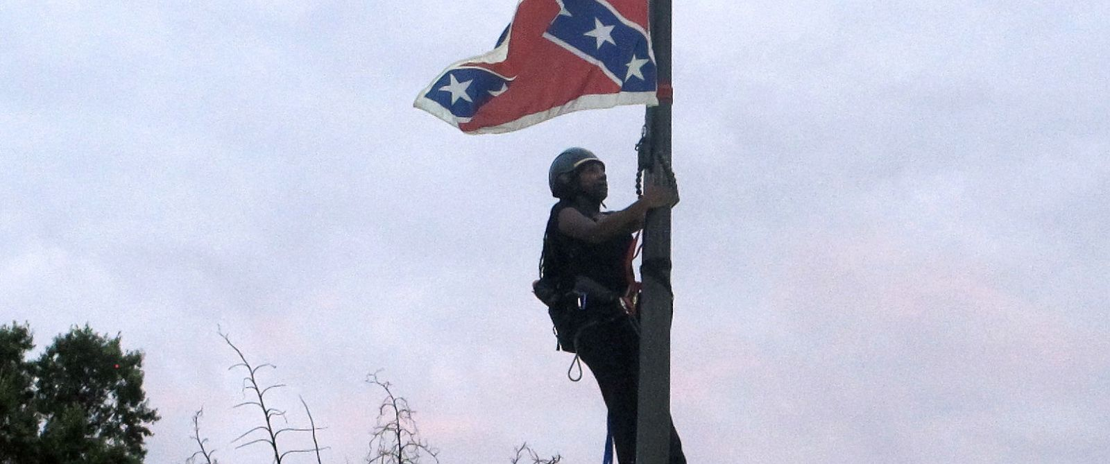 PHOTO: Bree Newsome of Charlotte, N.C., climbs a flagpole to remove the Confederate battle flag at a Confederate monument in front of the Statehouse, June, 27, 2015, in Columbia, S.C.
