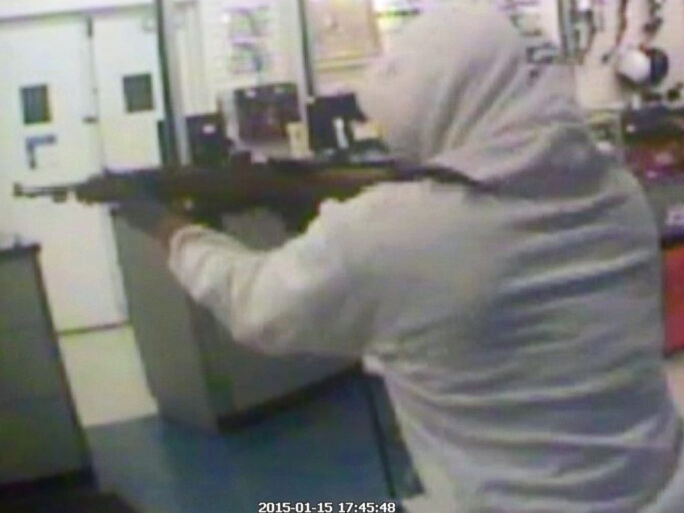 PHOTO: A suspect aims a rifle as he robs a pawn shop, Jan, 15, 2015, in Haines City, Fla., in this security camera video grab.