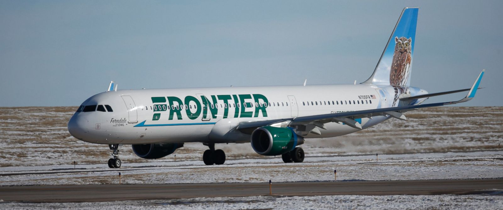PHOTO: In this photograph taken Feb. 8, 2016, a Frontier Airlines plane heads to a runway at Denver International Airport.