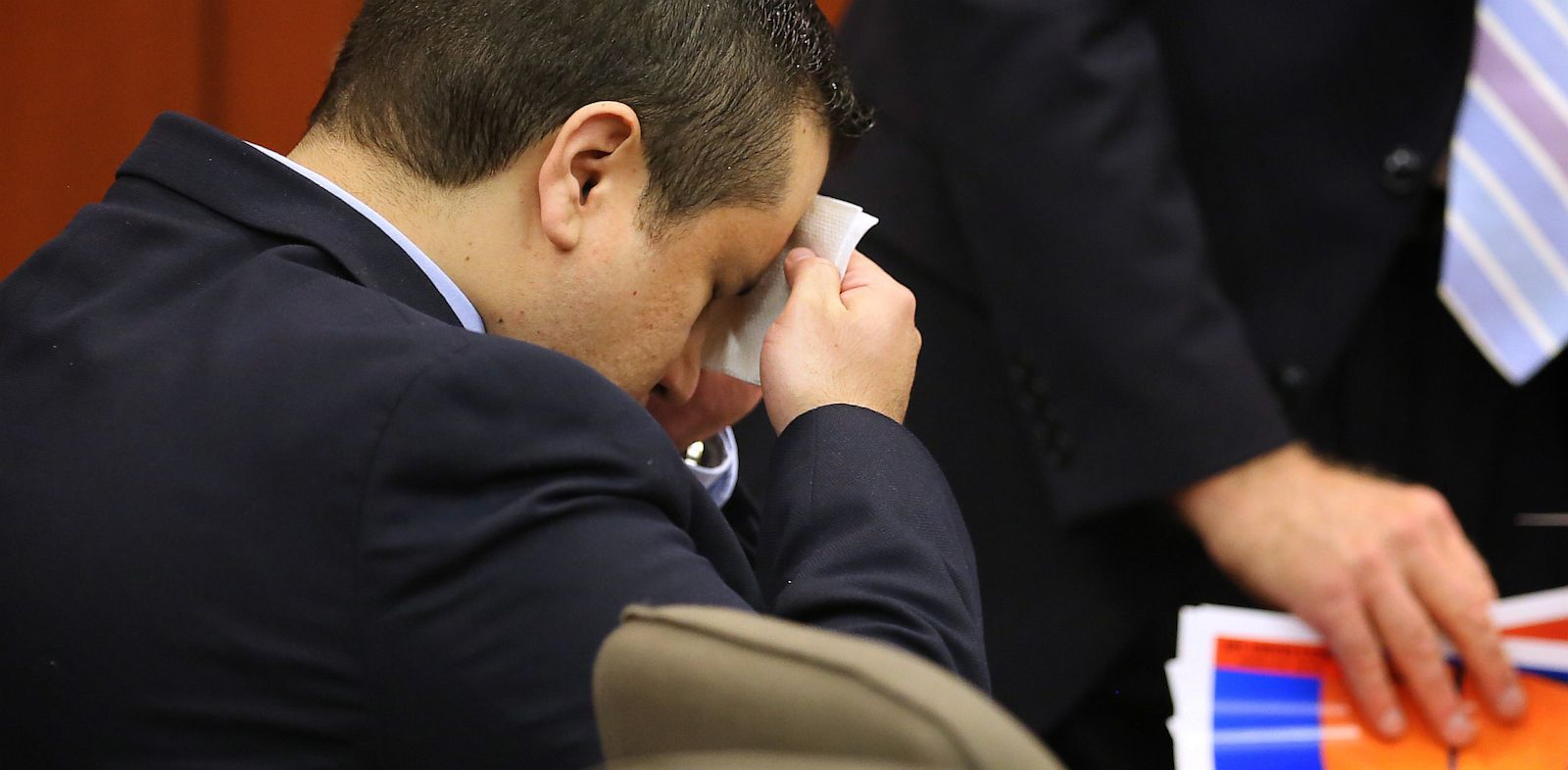 PHOTO: George Zimmerman wipes his face in the courtroom for his trial at the Seminole County Criminal Justice Center, in Sanford, Fla., July 12, 2013.