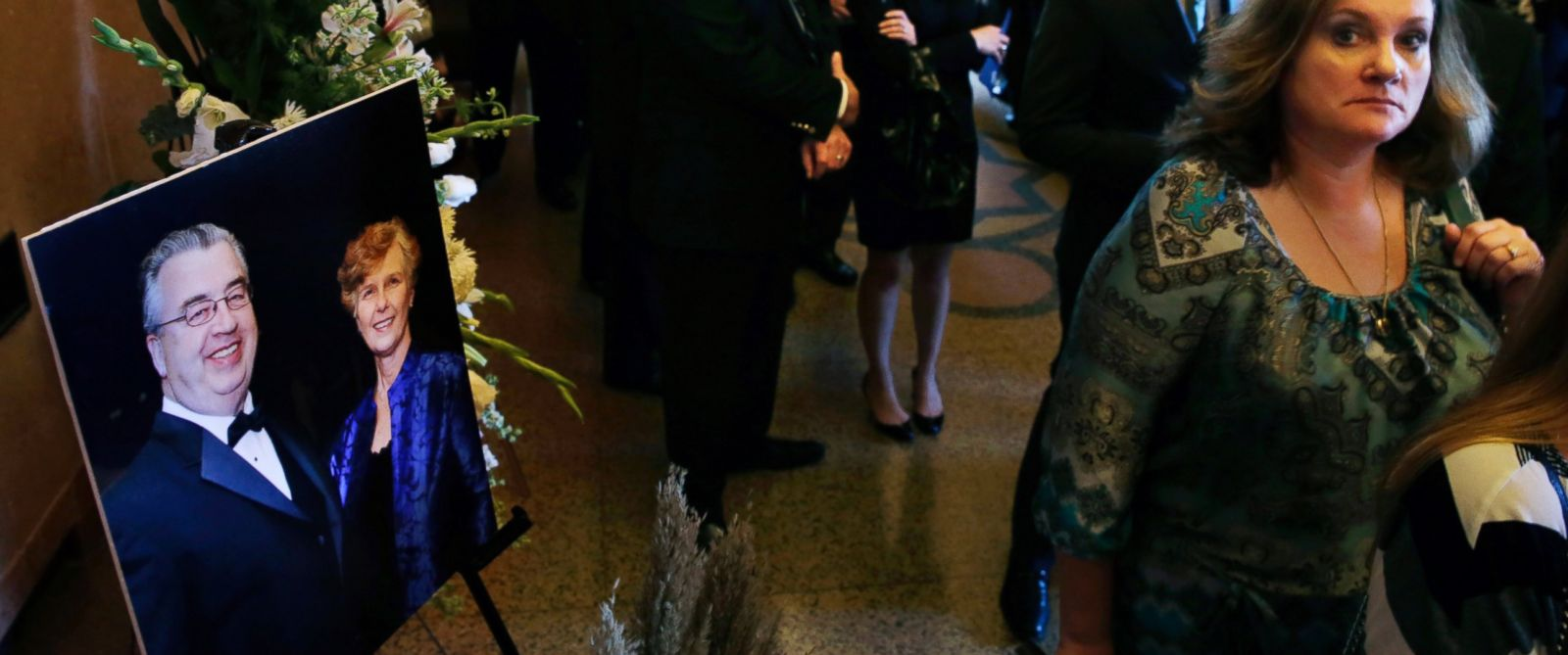 PHOTO: People file past a portrait of John and Joyce Sheridan, into a memorial service for the couple at the War Memorial, Oct. 7, 2014, in Trenton, N.J.
