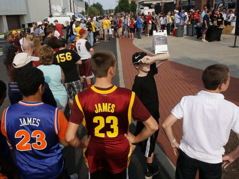 PHOTO: Fans wait in line to enter InfoCision Stadium for the LeBron James homecoming event