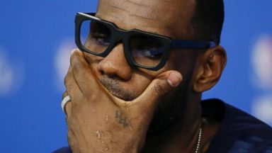 PHOTO: Miami Heat forward LeBron James listens to a question during a news conference after Game 5 of the NBA basketball finals against the San Antonio Spurs, June 15, 2014, in San Antonio.