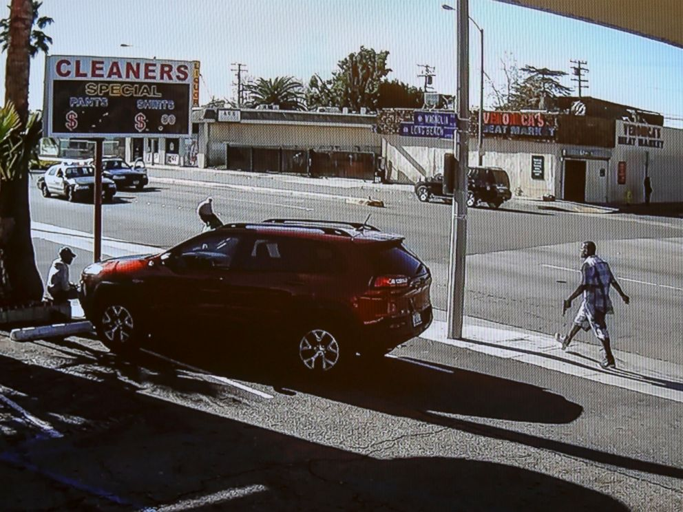 PHOTO: In this image made from security video footage provided by the Los Angeles County Sheriff, a man, right, walks with a gun in his hand, Dec. 12, 2015 in Lynwood, Calif.