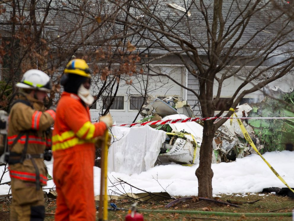 PHOTO: The wreckage of a small private jet sits in a driveway after crashing into a neighboring house in Gaithersburg, Md. on Dec. 8, 2014.