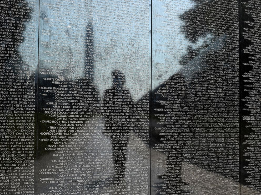PHOTO: Visitors are reflected in the Vietnam Memorial in Washington, May 27, 2016.
