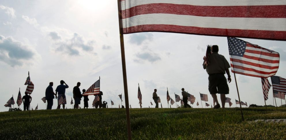 PHOTO: Scouts place thousands of flags on veterans graves at Brig. Gen. William C. Doyle Veterans Memorial Cemetery in honor of Memorial Day, May 27, 2016, in Wrightstown N.J.