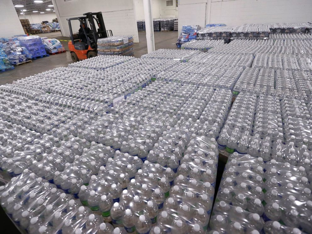 PHOTO: A forklift driver moves a pallet of water in a warehouse, Jan. 19, 2016, in Flint, Mich.