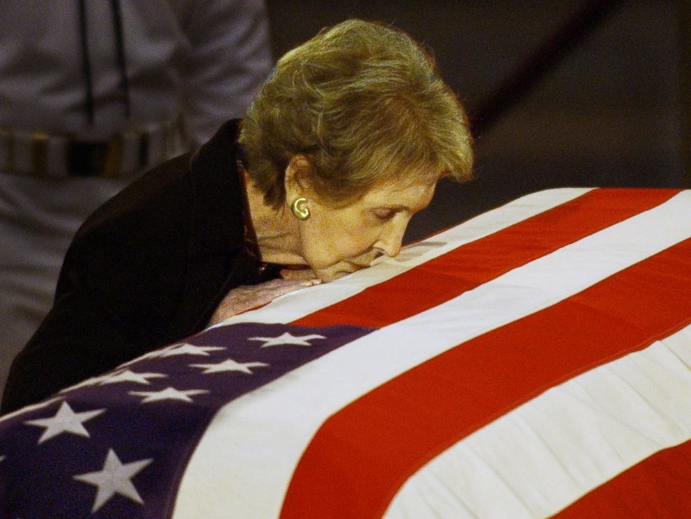 PHOTO: In this June 11, 2004, file photo, former first lady Nancy Reagan kisses the casket of her husband former President Ronald Reagan prior to the removal of his remains from the Capitol Rotunda in Washington.