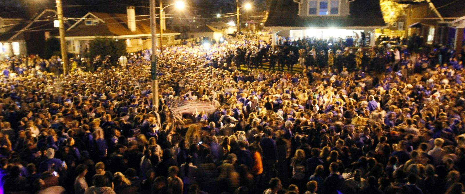 PHOTO: Kentucky fans react to their teams semi-final victory at the intersection of Elizabeth St. and State St., near the University of Kentucky campus, Saturday, April 5, 2014, in Lexington, Ky.
