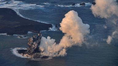 PHOTO: Smoke billows from a new island off the coast of Nishinoshima