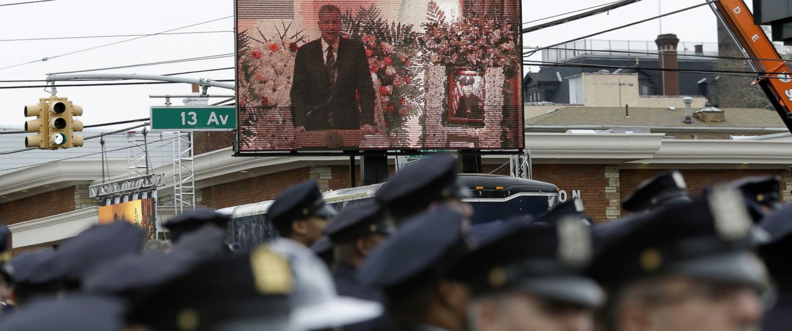 PHOTO: Some police officers turn their back to a large screen displaying New York City Mayor Bill de Blasio speaking during the funeral of Officer Wenjian Liu in the Brooklyn borough of New York, Sunday, Jan. 4, 2015.