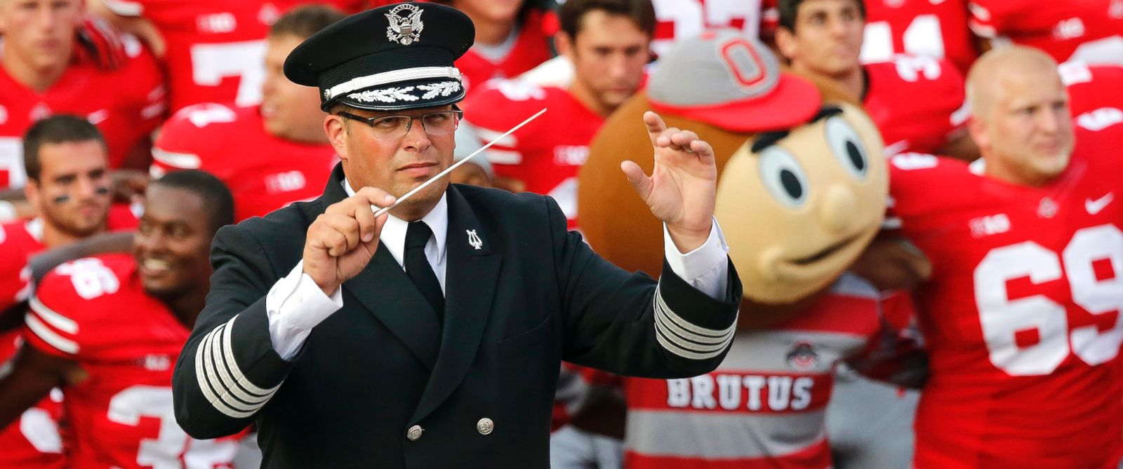 "PHOTO: Ohio State University marching band director Jon Waters leads the band in ""Carmen Ohio"" following a NCAA football game against San Diego State at Ohio Stadium in Columbus, Ohio, Sept. 7, 2013."