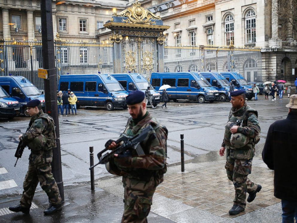 PHOTO: French soldiers patrol outside the Paris hall of Justice, March 30, 2016, while Frenchman Reda Kriket is being questioned by a magistrate.