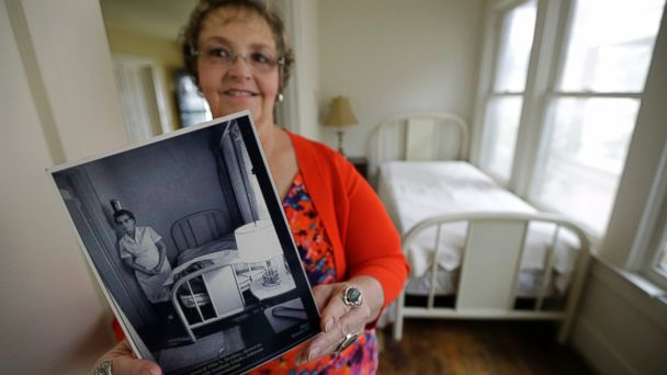 PHOTO: Patricia Hall holds a photograph of her grandmother, Gladys Johnson, while standing in the 5-by-14 room that Lee Harvey Oswald rented in 1963 at her familys boarding house in Dallas.