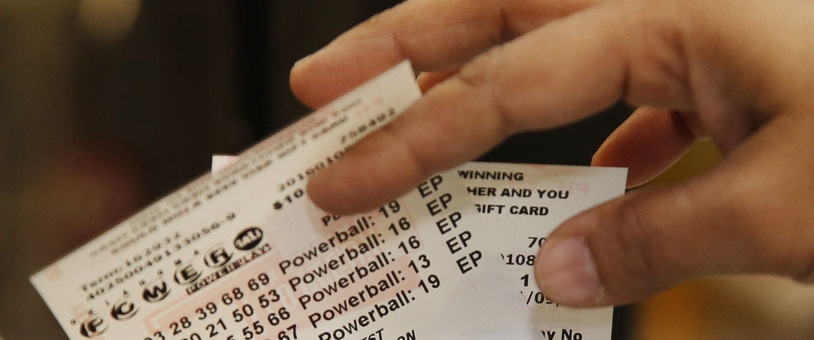PHOTO: Momtaz Parvin pulls Powerball lottery tickets from the printer at her store in Oklahoma City, Jan. 8, 2016, as the multi-state jackpot reaches $800 million.