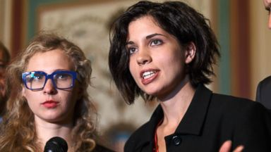 PHOTO: Russian political activists Nadya Tolokonnikova, center, and Maria Alyokhina, left, of the Russian punk band Pussy Riot speak in Washington, May 6, 2014.