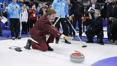 PHOTO: Will Ferrell as Ron Burgundy releases a rock as Glenn Howard and his team look on