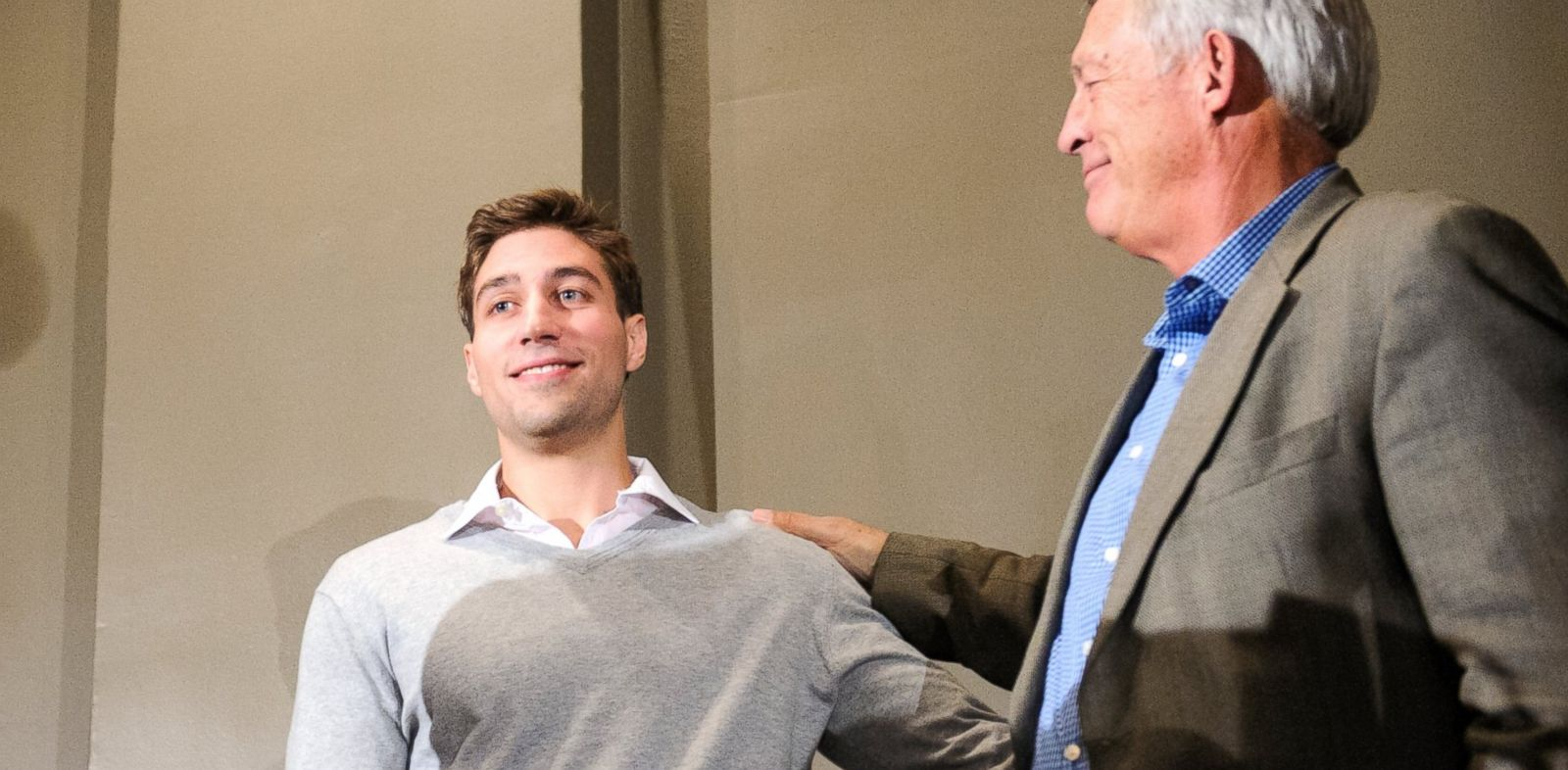 PHOTO: Ryan Ferguson, right, and his father Bill Ferguson share a moment during a press conference in Columbia, Mo., after Ryans release from prison.