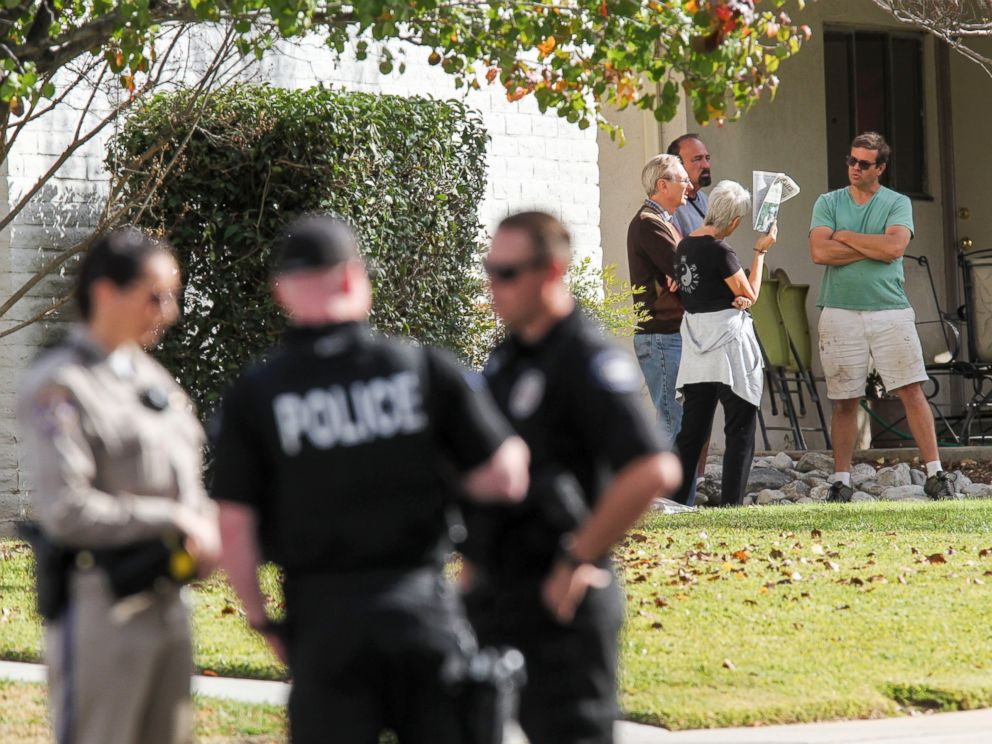 PHOTO: People gather in the neighborhood near the home in connection to the shootings in San Bernardino, Dec. 3, 2015, in Redlands, Calif.