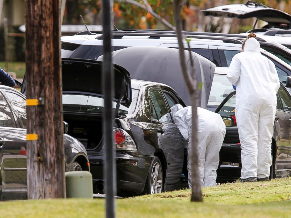 PHOTO: FBI agents investigate a car near a home in connection to the shootings in San Bernardino, Dec. 3, 2015, in Redlands, Calif.