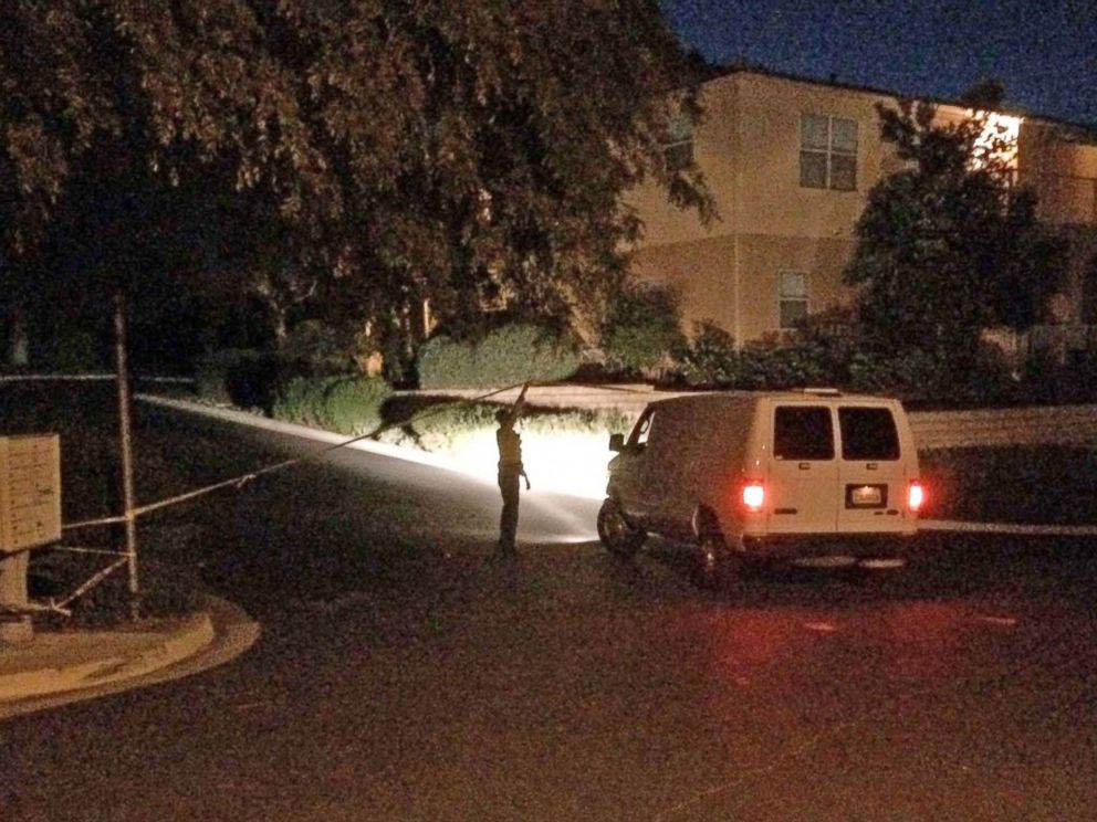 PHOTO: A sheriffs deputy lifts crime scene tape to allow a Coroners Bureau van to proceed up Greenhill Way as the Santa Barbara County Sheriffs Office opened a homicide investigation between Santa Barbara and Goleta, Calif., March 24, 2016.