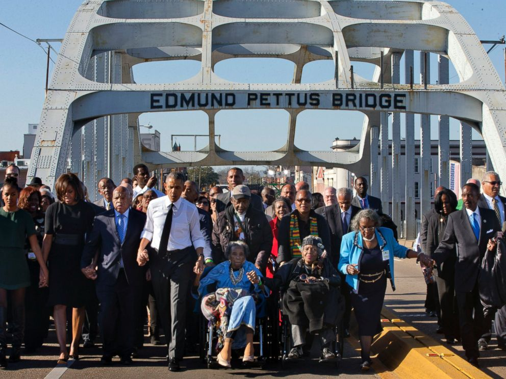 PHOTO: President Barack Obama, holding hands with Amelia Boynton, as they and the first family and others including Rep. John Lewis, D-Ga, left of Obama, walk across the Edmund Pettus Bridge in Selma, Ala. , Saturday, March 7, 2015.
