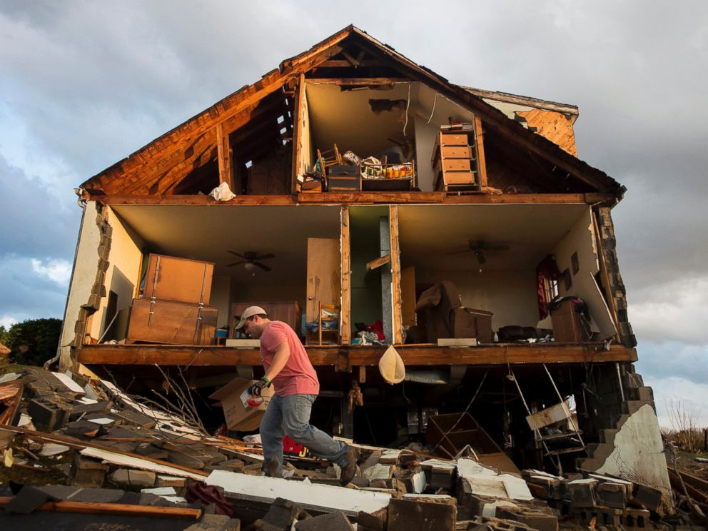 PHOTO:Nick Mobley helps clean up a house owned by a family friend, Feb. 24, 2016, after a storm hit Appomattox County, Va.