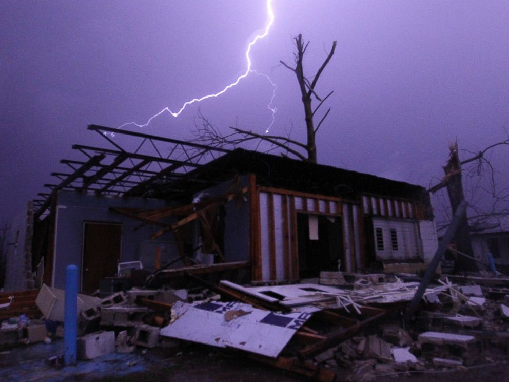 PHOTO: Lightning illuminates a house after a tornado touched down in Jefferson County, Ala., damaging several houses, Friday, Dec. 25, 2015, in Birmingham, Ala. A Christmastime wave of severe weather continued Friday.