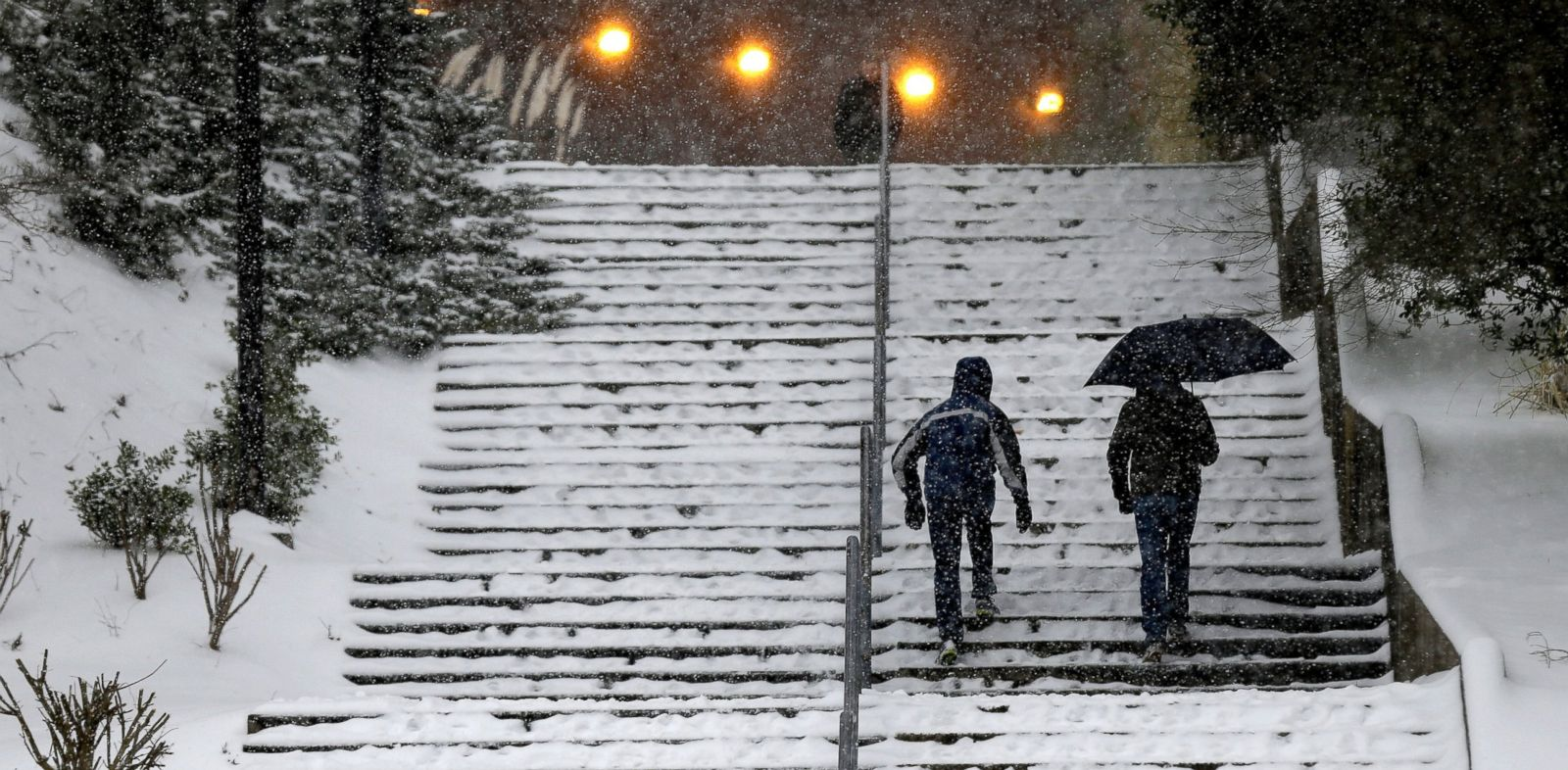 PHOTO: Pedestrians maneuver a stairway outside the Dean E. Smith Center at the University of North Carolina, Feb. 12, 2014, in Chapel Hill, NC.