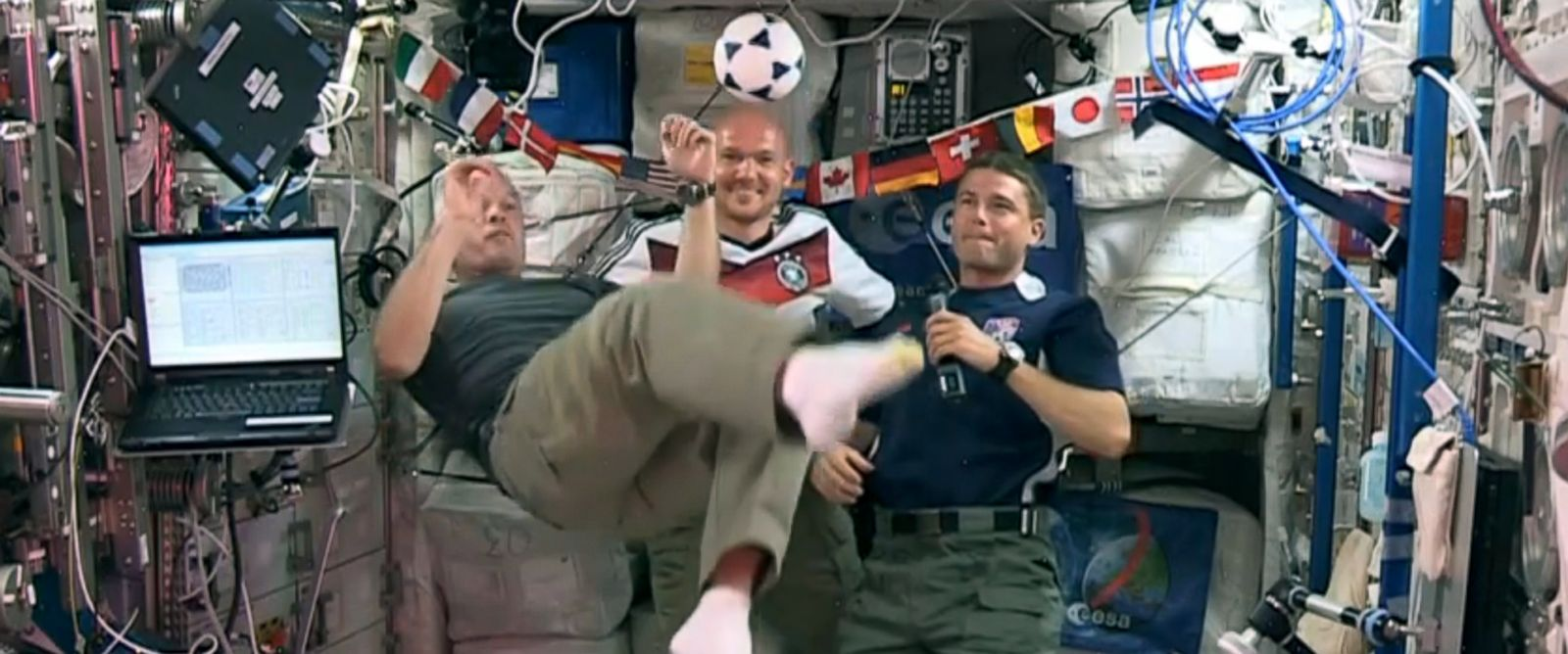 PHOTO: Astronauts Steve Swanson, left, Reid Wiseman, right, and German astronaut Alexander Gerst, center, kick around a soccer ball some 230 miles above Earth aboard the International Space Station.