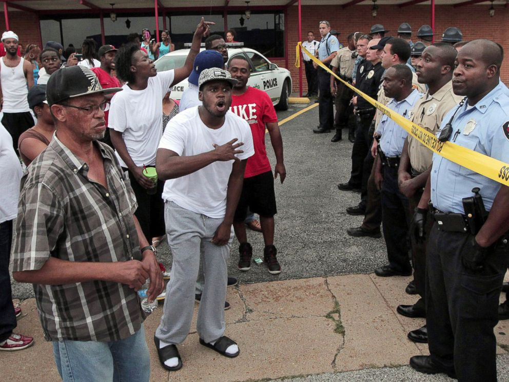 PHOTO: A crowd is stopped by police as they were trying to reach the scene where 18-year-old Michael Brown was fatally shot by police in Ferguson, Mo., near St. Louis on Saturday, Aug. 9, 2014.