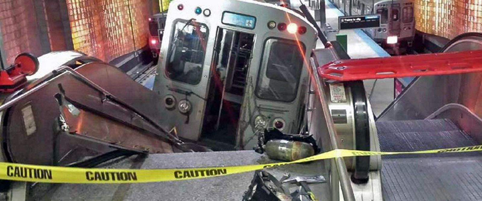 PHOTO: A Chicago Transit Authority train car rests on an escalator at the OHare Airport station after it derailed, March 24, 2014, in Chicago.