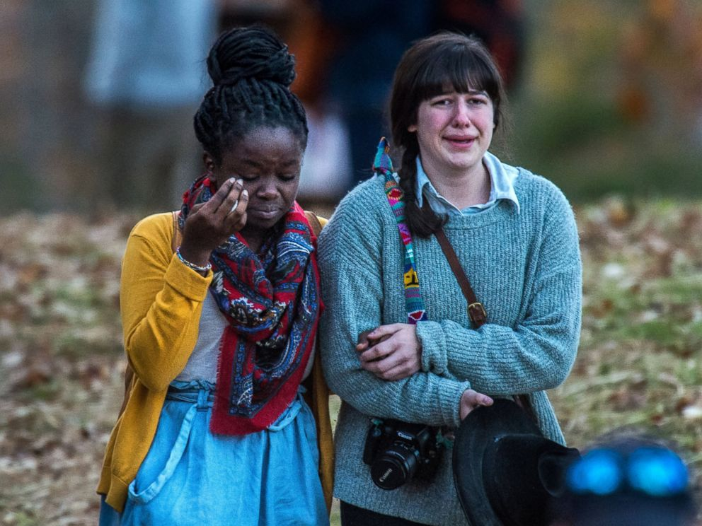 PHOTO: Girls console each other as they walk away from the scene of the accident where one of their friends allegedly fell off the train trestle which crossed the James River at Riverside Park, Nov. 8, 2014.